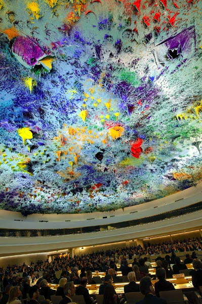 A general view shows the renovated Room XX with its ceiling painted by artist Miquel Barcelo during its inauguration on November 18, 2008 at the United Nations offices in Geneva. Top contemporary Spanish artist Barcelo was commissioned to create a unique ceiling painting for Room XX, which will host the UN Human Rights Council.  The renovated venue, which costs some 18.5 million euros (23.2 million US dollars), was inaugurated by UN Secretary-General Ban Ki-moon and Spanish King Juan Carlos. AFP PHOTO / FABRICE COFFRINI SWITZERLAND-UN-RIGHTS-ART-SPAIN-BARCELO